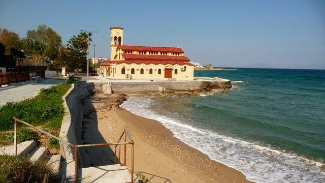 Vravrona sandy beach with Panagia church background