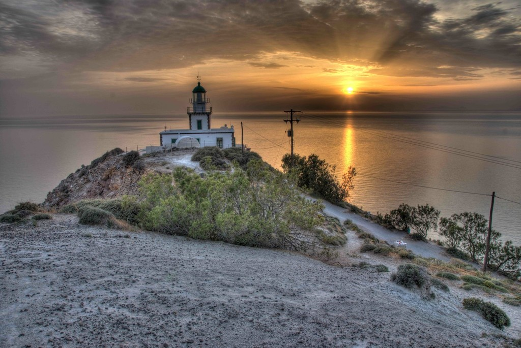 Santorini lighthouse during sunset