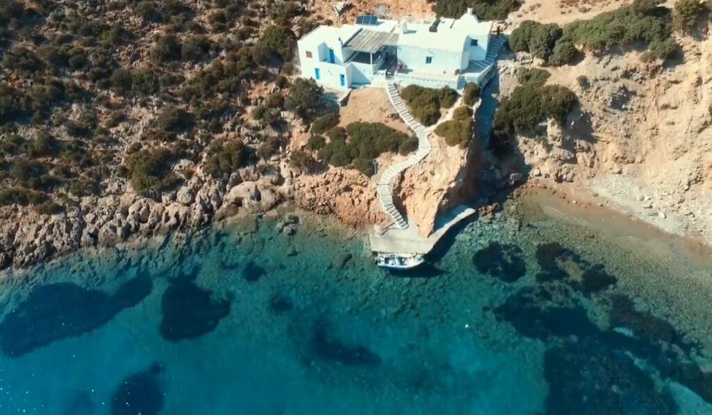 Overview of FYkiada Beach in Sifnos with a beautiful seaside church