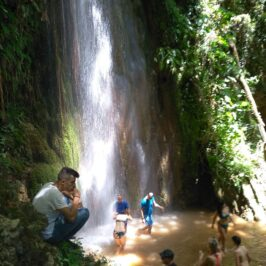 Nemouta waterfalls pool with people under the water
